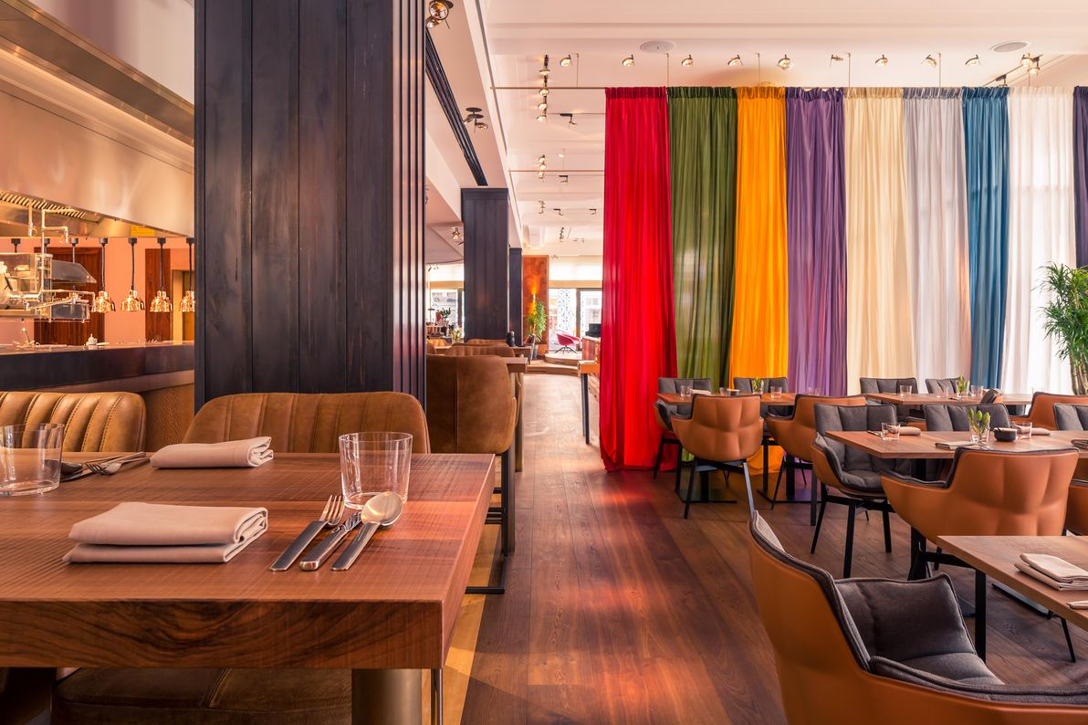 Interior view of the OraniaBerlin restaurant in Kreuzberg with colourful curtains and stylish furniture